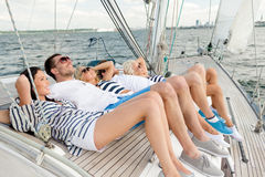 Smiling friends lying on yacht deck Stock Photography