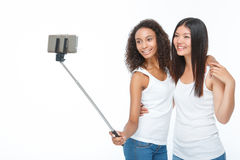 Smiling friends making selfie royalty free stock photography