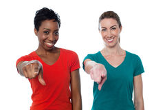 Smiling friends pointing to you stock photos