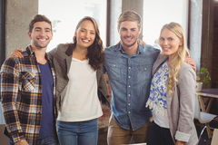 Smiling friends putting arms around each other Stock Photography