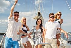 Smiling friends sailing on yacht Stock Photo