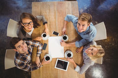 Smiling friends sitting and drinking coffee Stock Photo