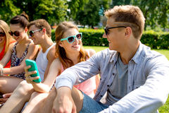 Smiling friends with smartphone making selfie Stock Images