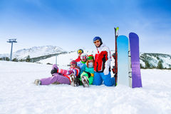 Smiling friends with snowboards in the mountains Royalty Free Stock Image