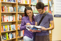 Smiling friends student reading textbook Royalty Free Stock Photography