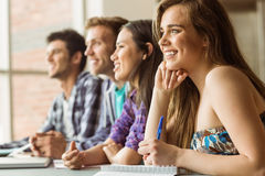 Smiling friends students talking and writing Royalty Free Stock Photos