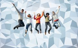 Smiling friends in sunglasses jumping high Stock Photos
