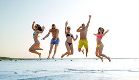 Smiling friends in sunglasses on summer beach Royalty Free Stock Photo