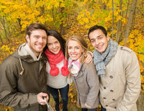 Smiling friends taking selfie in autumn park Royalty Free Stock Image