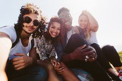Smiling friends taking selfie on a holiday Royalty Free Stock Image
