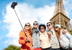 Smiling friends taking selfie with smartphone Stock Image