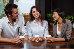 Smiling friends talking royalty free stock image