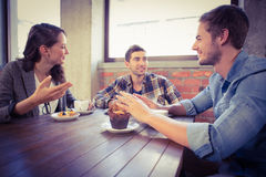 Smiling friends talking and enjoying coffee Stock Image