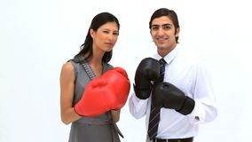Smiling friends using boxing gloves Royalty Free Stock Photos