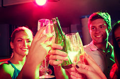 Smiling friends with wine glasses and beer in club Stock Photos