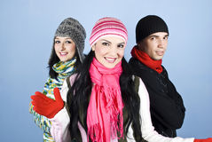 Smiling friends in winter clothes royalty free stock image