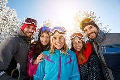 Smiling friends on winter vacation royalty free stock photography