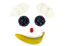 Smiling fruits on a white background Royalty Free Stock Images