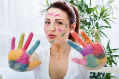 Smiling funny attractive woman with colorful hands Stock Photos
