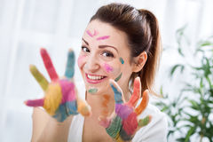 Smiling funny attractive woman with colorful hands Stock Photography