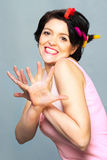 Smiling funny brunette woman in curlers crossed her hands Royalty Free Stock Photos
