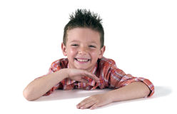 Smiling funny child. Whit hair crest Stock Photo