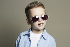 Smiling Funny child.fashionable little boy in sunglasses Royalty Free Stock Image