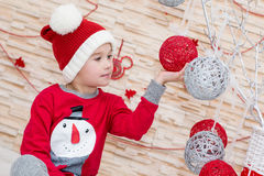 Smiling funny child in Santa Stock Photography