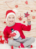 Smiling funny child in Santa Royalty Free Stock Photo