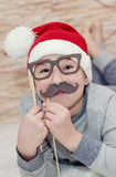 Smiling funny child in Santa Royalty Free Stock Photography