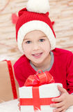 Smiling funny child in Santa Royalty Free Stock Image