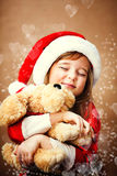 Smiling funny child  in Santa red hat Royalty Free Stock Photo