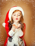 Smiling funny child  in Santa red hat Royalty Free Stock Photography
