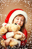 Smiling funny child  in Santa red hat Stock Photos