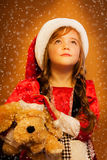 Smiling funny child  in Santa red hat Royalty Free Stock Image