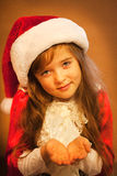 Smiling funny child  in Santa red hat Royalty Free Stock Images