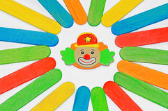 Smiling funny clown face. On the colorful  background Stock Photography
