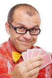 Smiling gambler holding playing cards Royalty Free Stock Photos