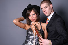 Smiling gangsters. A couple of romantic gangsters Royalty Free Stock Images