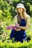 Smiling  gardener in blue uniform Royalty Free Stock Photos