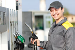 Smiling gas station worker at work Stock Image
