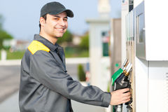 Smiling gas station worker at work Royalty Free Stock Images