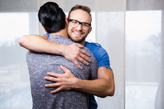 Smiling gay couple embracing Royalty Free Stock Photography