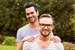 Smiling gay couple hugging Stock Photos