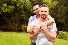 Smiling gay couple hugging Royalty Free Stock Photo