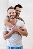 Smiling gay couple hugging Royalty Free Stock Photography