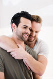 Smiling gay couple hugging. At home royalty free stock photos