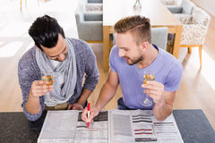 Smiling gay couple surrounding ads Royalty Free Stock Photo
