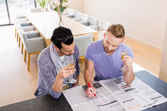 Smiling gay couple surrounding ads Royalty Free Stock Photos