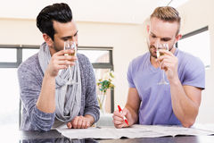 Smiling gay couple surrounding ads Stock Photography